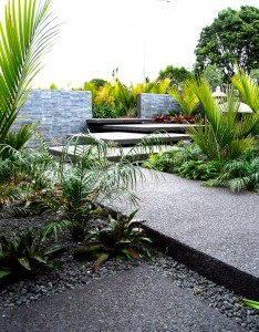 concrete slabs surrounded by planted landscape