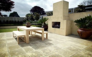 outdoor fireplace and stone paving