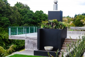 outdoor fireplace with planter box