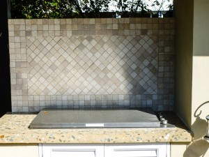 concrete benchtop and gas stove outdoor fireplace